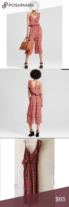 NWT One Shoulder Ruffle Jumpsuit BRAND NEW WITH TAGS• good condition ruffle jumpsuit• thin strap on one side with ruffled sleeve on the other side w/ wide cropped pants• 100% Polyester   • Offers Welcome • Bundle Discounts  • Suggested User • Fast Shipper Xhilaration Pants Jumpsuits & Rompers