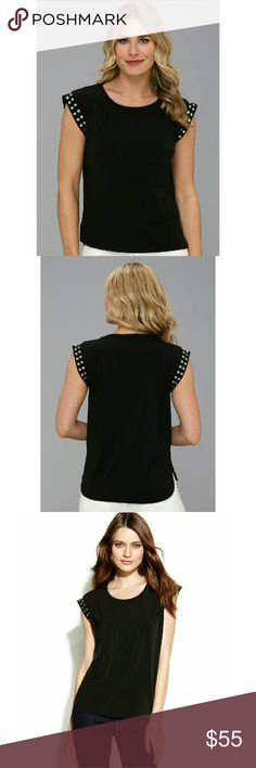 New! MICHAEL KORS Studded Sleeve Top Blouse NWT Anything but basic: MICHAELMichael Kors' cap-sleeved tee looks ultra-cool with stud accents and a modern silhouette. A standout on its own or layered with a crisp jacket!  * Brand New With Tags   * Glamorous silver-tone studded accents adorn the cap sleeves  * Pleats at front shoulders  * High-low hemline with split side seams  * Scoop neckline  * Pullover style. Easy fit  * Hits at hip  * Polyester/spandex.  Machine washable  * Retails for…