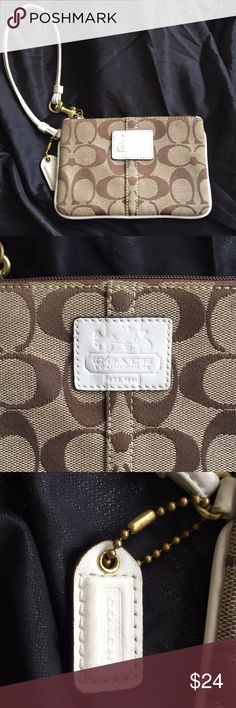 Coach Beige and White Wristlet Good condition - wear on label and a blue pen mark. Otherwise in good shape. Coach Bags Clutches & Wristlets