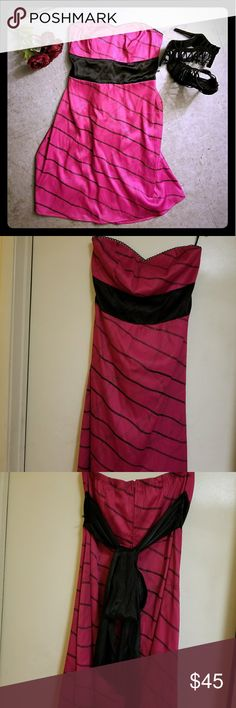 Sassy Lil Dress NWT, cute hot pink and black dress w/glitter stripes. Never worn. Absolutely adorable. Perfect for a dinner date, office party, church (with a sweater of course ;-)) summer wedding or bridal party, dancing or just because you feel like dressing up. Plus girl size 12. Make me an offer. 🛍 torrid Dresses Strapless