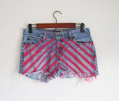 Light blue jean shorts with pink stripe details