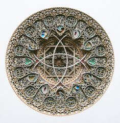 Stained glass tends to be made from, well, glass. But artist Eric Standley makes gorgeous and intricate designs reminiscent of the finest stained glass windows on earth using only one material—paper.