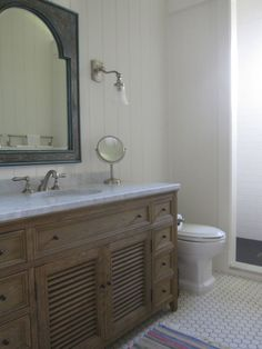 Guest Bathroom Restoration Hardware vanity and Carrera marble counter, classic tile floor, wall sconces.