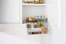 Maximize pantry storage space and keep spices organized with the Rubbermaid Pull Down Spice Rack. This spice rack organizer securely mounts on cabinet shelving and simply pulls down to display spice jars, making it easier than ever to access. Spice Rack Organiser, Spice Organization, Organizing, Corner Storage, Storage Spaces, Storage Ideas, Pantry Storage, Kitchen Set Up, Home