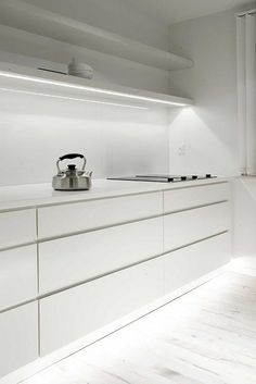 Low lighting in white kitchen
