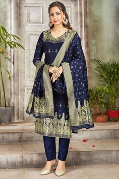 Exquisitely embroidered with traditional design, this navy blue banarasi silk trouser suit will make you absolutely classy. This V neck and 3/4th sleeve wedding wear attire perfectly formed using woven zari work. Along with banarasi silk cigarette pants in navy blue color with navy blue banarasi silk dupatta. Cigarette pant is plain. #trousersuit #salwarkameez #malaysia #Indianwear #Indiandresses #andaazfashion