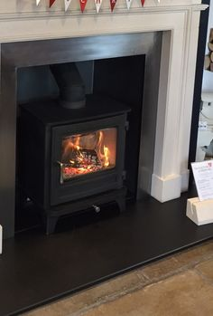 Chesneys Salisbury 5 woodburning stove in black. Available in alternative finishes. Brick Fireplace Log Burner, Fireplace Surrounds, Fireplace Ideas, Living Room With Fireplace, Living Rooms, Interior Design Living Room, Kitchen Interior, Fire Surround, Lake Cabins