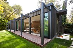Ornament Storage Container Exterior Modern with Board and Battan Contemporary Deck Flat Roof Glass Doors Large Windows Metal