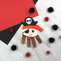 This handprint pirate craft is a perfect blend of arts and crafts that kids will love doing over the summer! Learn how to make your child's hand into a pirate with this simple DIY project. It's great for boys and girls in preschool, ki Disney Crafts For Kids, Summer Crafts For Kids, Fathers Day Crafts, Easy Crafts For Kids, Toddler Crafts, Preschool Crafts, Fun Crafts, Preschool Kindergarten, Preschool Pirate Crafts