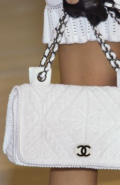 White Chanel....[i would so love to own one of these classic chanel bags]. I don't know how anyone my age has one 10k for a purse isn't bad i suppose [when birkins run 10-100k] it blows my mind.