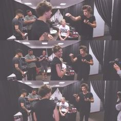 Harry showing Louis how to punch..SO CUTE! :))
