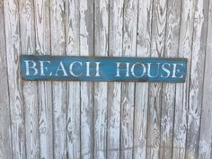 A personal favorite from my Etsy shop https://www.etsy.com/listing/486283939/beach-house-sign-70-color-options-wood