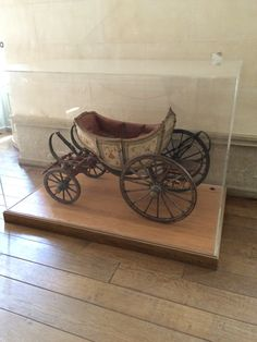 Baby carriage in entry of petite Trianon, Versailles
