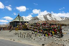 Taglang la pass... With prayer flags and rock statues