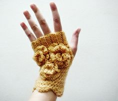 Ravelry: Mustard Fingerless Gloves with Flowers pattern by faima othman