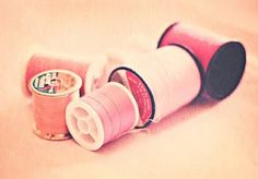 pink spools of thread