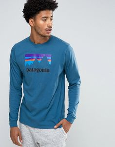 Get this Patagonia's printed t-shirt now! Click for more details. Worldwide shipping. Patagonia Long Sleeve Top Shop Sticker Logo Regular Fit in Blue - Blue: Top by Patagonia, Soft-touch organic cotton jersey, Crew neck, Patagonia logo, Long sleeves, Regular fit - true to size, Machine wash, 100% Organic Cotton, Our model wears a size Medium and is 189cm/6'2.5 tall. Ready made for the great outdoors, Patagonia create high-quality clothing for the all-round active. Committed to protecting the…