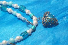 Icy Blue Caged Heart Necklace with Faux Pearls by LizsWares