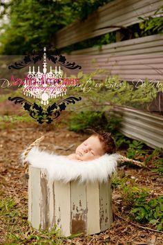 Newborn baby boy in weathered bucket.  Outdoor newborn session.  www.TheAthensNewbornPhotographer.com