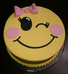 Winking emoji cake
