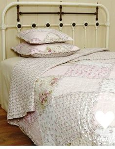 Shabby Chic-old quilt and brass or iron bed