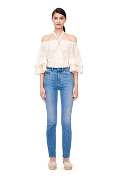 An off-the-shoulder top in cotton eyelet with ruffled sleeves.