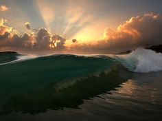 National Geographic hawaii | Picture of a wave breaking at sunrise in Oahu, Hawaii