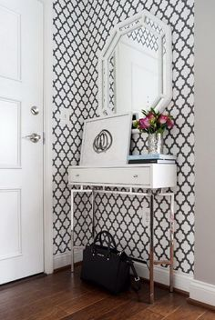 Adding Graphic Wallpaper Brings Dimension to a Small Entryway. Consider wallpaper that have colors in it reflective to the colors in the den curtains