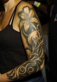 Image result for sleeve tattoos lilies womens