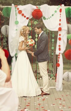 YES - Decor: They like the concept, use in their colors. JC&LYSSA: What do you like about this pic that we want to incorporate? (i.e. draping curtain, pompom ball, circle garlands)