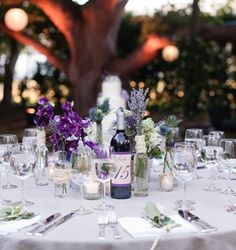 Wine Bottle as Table Number!  Have a marker that can write on glass and have people leave you a message.  This way, the table # represents the year of your anniversary and you can keep all of the bottles.