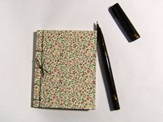 Florentine Floral Notebook - small notebook covered with traditional Florentine floral paper.  Contains 60 sheets of buttery-cream text paper. Hand bound with deep green linen thread.