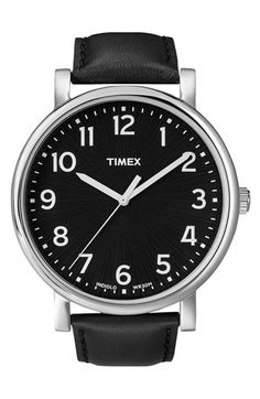 Timex Easy Reader, white on black. A cheaper alternative to a Mondaine Swiss Railways watch.
