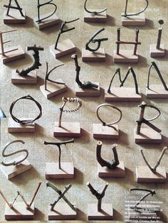 Creating letters with sticks and wire. {source unknown}