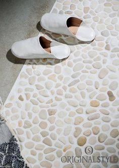 Created from pebbles Ivory Samoa mosaic tiles bring a natural look to spa style bathroom walls and bathroom floors.