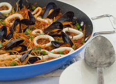 Ingrid Hoffmann's Catalan noodle paella with calamari and mussels. #recipe