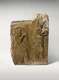 Relief: two servants bearing food and drink, ca. 358–338 B.C. Iran, Persepolis. The Metropolitan Museum of Art, New York. Harris Brisbane Dick Fund, 1934 (34.158) | Representations of hundreds of alternating Persian and Median servants bringing food and drink for a royal feast such as in this relief are on the walls of several palace stairways at Persepolis.