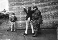 British soldier searching a Belfast teenager. (Photo by Keystone/Getty Images). 1971