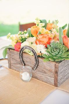 rustic succulent wooden box and horseshoe wedding centerpiece
