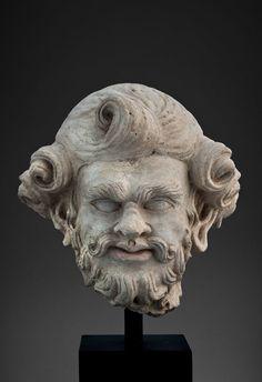 Head of a bearded man (Silenus or Atlas) 2nd century AD - 3rd century AD. Gandhāra. | Museo d'Arte Orientale