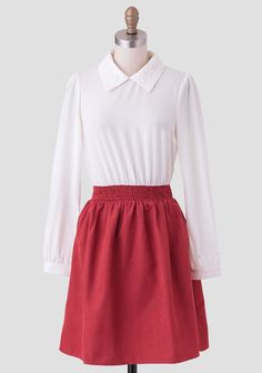 This darling colorblocked dress features a silky rust-hued skirt with a shirred waistline and a solid ivory-hued long sleeve top. Finished with a chic collar with crochet detailing and a keyhole ...