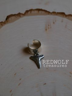 SALE Silver Shark Tooth Ear Cuff. $7.00, via Etsy.