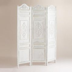 Our beautiful, versatile Victorian Screen is a great room divider as well as a decorative accent. The Victorian-inspired design presents an elegant, antique appeal. It's crafted of mango wood with a distressed, antique white painted finish, and exquisite details on each of its three hinged panels.