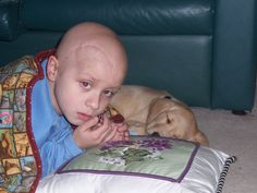 Trent at the age of 6. He got a new puppy, Rex, after surgery to remove a brain tumor. Trent died one year later, mom Donna Childers writes.
