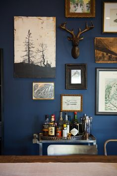 Navy gallery wall with industrial bar cart