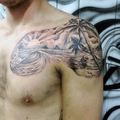 Wonderful looking beach tattoo on the shoulders. The design is small yet artistic enough to fit on the shoulder. It shows the beach and how the waves are slowly crashing on to each other.