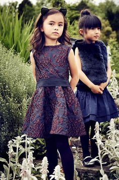Dress left by Lanvin Petite, dress right by Il Gufo, shaggy vest by Hucklebones all at Kids 21 boutique now online for kids fashion shopping