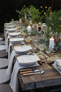 such a beautiful table setting. and i'll take that chunky rustic table too. looks like an old door.