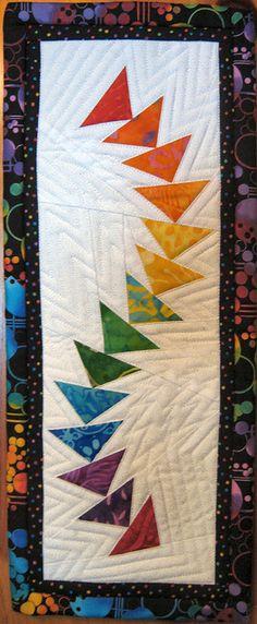 Rainbow Flying Geese original design by Marie Joerger.