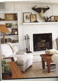 White rustic living room....wide plank floors and walls.....likey